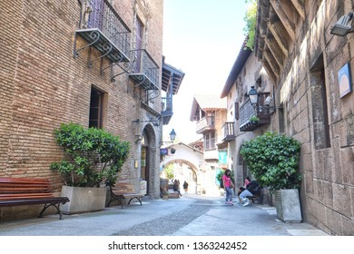 Barcelona, Spain - 04.22.2017: The Poble Espanyol is an open-air architectural museum in Barcelona, approximately 400 metres away from the Fountains of Montjuïc. A street in the shadow