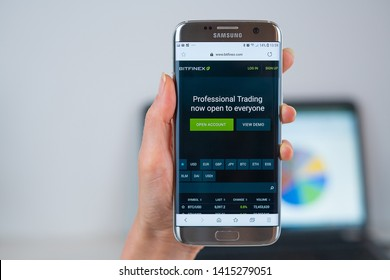 Barcelona / Spain 05 25 2019: Bitfinex trade web site on mobile phone screen. Mobile version of Bitfinex company web page on smartphone. Official web page of Bitfinex trade.