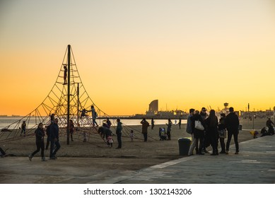 Barcelona, Spain - 05.12.2018: Beautiful sunset on the Barceloneta Beach near a Rope Playground Equipment for Kids