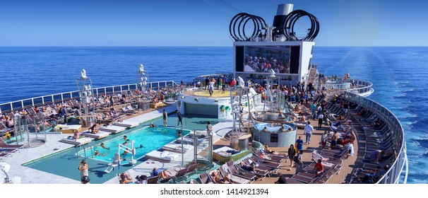 BARCELONA, SPAIN- 06 NOVEMBER, 2018: An aerial view of a cruise ship pool area with people in the open sea