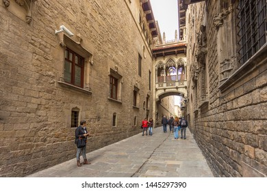 Barcelona, Spain- 09 November 2014: Bridge over the Carrer del Bisbe by Joan Rubio. Neo-gothic, bishop street.