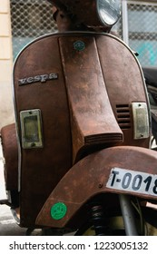 Barcelona / Spain - 10 19 2018: Front of an old and rusty Piaggio Vespa. Seems like a Vespa PK which was introduced in 1982. Piaggio Vespa PK came with 50, 80, 100 and 125cc engines.
