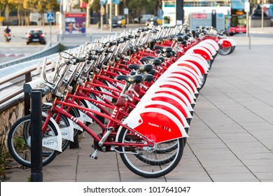BARCELONA, SPAIN - 11 JANUARY 2018: Rental and parking of pleasure bicycles in the city of  Barcelona in Spain.