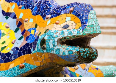 BARCELONA, SPAIN - 13 JANUARY 2018: Elements of mosaic fragments Gaudi's mosaic work in Park Guell In winter in the city of Barcelona.