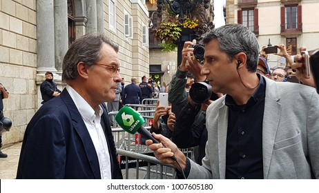 Barcelona, Spain - 1st October 2017: A reporter of a Spanish tv broadcast channel interviewing Artur Mas outside Palau de la Generalitat the day of the Catalan independence referendum