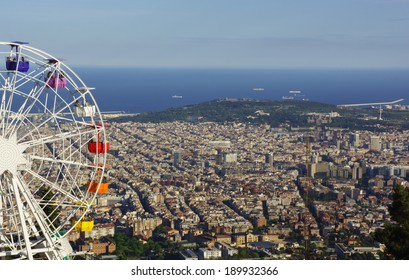 Barcelona, Spain - 2014, April 27: People on a huge ferris wheel with panoramic view over Barcelona.