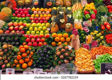 Barcelona Spain 2017-La boqueria market.Fresh fruits market.Spanish world famous place, food marketplace, fruits market stall with mango, peach and fruit juice.