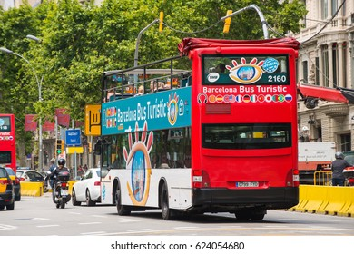 BARCELONA, SPAIN - 22 MAY 2013: A City Sightseeing Barcelona tour bus in city traffic, shot with motion blur