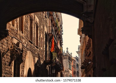 Barcelona, Spain - 26th October 2019: View below the gothic bridge in Gothic Quarter of Barcelona, Carrer del Bisbe