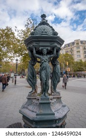 Barcelona, Spain - 27 November, 2018: a small bronze sculpture of four women, located in the city center on a street passeig de gracia