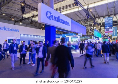 Barcelona, Spain 28 02 2019: People walking in front of Qualcomm mobile world congress stand