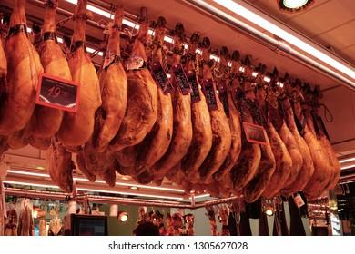 Barcelona, Spain - 28 January 2019: Spanish jamon in in the La Boqueria market, jamon iberico in view black leg pork, traditional national Spain meat in store.