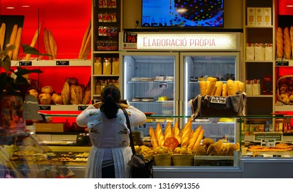 Barcelona, Spain - 30 January 2019: Mercat de la Concepcio, market in Barcelona, Spain. Bakery with different kinds of bread, cakes and buns.