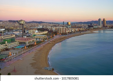 BARCELONA, SPAIN -4 JAN 2018- Sunset view of the Barceloneta beach and the Mediterranean Sea in Barcelona, the capital of Catalonia in Spain, seen from the W Hotel.