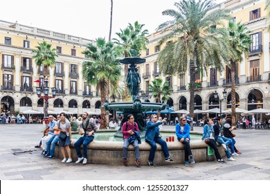 Barcelona, Spain - 4th October 2017: in Placa Reial just off La Rambla. The square is popular for dining and nightlife.