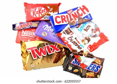 BARCELONA, SPAIN - APR 15, 2017: A bunch of chocolate bars, including Snickers, Twix, Crunch, Milka, Kit Kat, Kinder Bueno and Kinder Schoko-bons, isolated on white background.