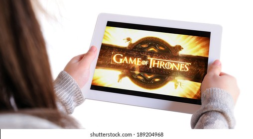 BARCELONA, SPAIN - APR 18, 2014: Unrecognizable woman watching, on her Apple Ipad, Game of Thrones, a famous American fantasy drama television series created for HBO, isolated on white background.