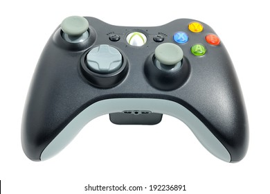 BARCELONA, SPAIN - APR 18, 2014: The wireless gamepad for the Xbox 360, a home video game console produced by Microsoft, isolated on white background.