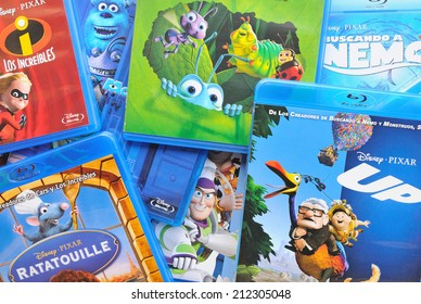 BARCELONA, SPAIN - APR 18, 2014: A collection of films by Disney Pixar Animation Studios on Blu-ray, including Finding Nemo, Up, Wall-e, Toy Story, Monsters and Ratatouille.