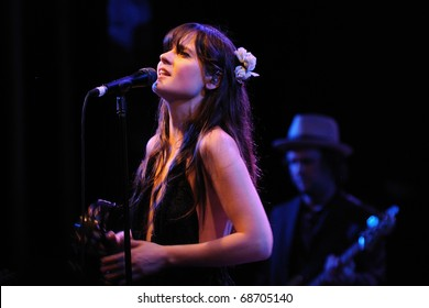 BARCELONA, SPAIN - APR 25: Zooey Deschanel, Hollywood Actress and singer, performs with her band She & Him at Apolo on April 25, 2010 in Barcelona, Spain. She performs with Matt Ward.