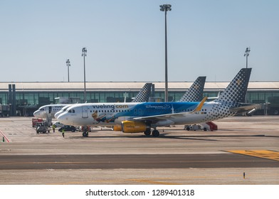 BARCELONA, SPAIN - APRIL 04, 2018:Planes of the Spanish company Vueling on the airfield of the international airport El Prat, Barcelona, Spain