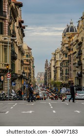 Barcelona, Spain, April 12, 2012: Street view with people crossing, and cars driving, 2012: Street view with people crossing, and cars driving