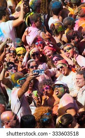 BARCELONA, SPAIN - APRIL 12, 2015: Happy people at  Festival de los colores Holi in Barcelona