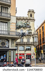 BARCELONA, SPAIN - APRIL 14, 2018: Famous La Rambla - major tourist attraction, after the rain. La Rambla Boulevard is one of the most recognized streets in the world. Catalunya, Spaine.