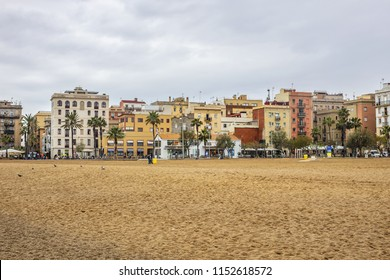 BARCELONA, SPAIN - APRIL 14, 2018: View of Barceloneta beach and promenade. Barceloneta beach is oldest and most famous in city of Barcelona, located in neighborhood of La Barceloneta (Ciutat Vella).