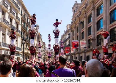 BARCELONA, SPAIN - APRIL 14: Castellers de Barcelona in April 14, 2013 in Barcelona, Spain. Castell - Traditionally Catalan show is human tower built traditionally in festivals at Catalonia