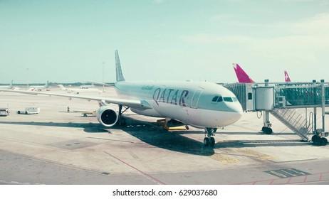 BARCELONA, SPAIN - APRIL, 15, 2017. Close-up pan shot of Qatar Airways Airbus airliner boarding at the airport