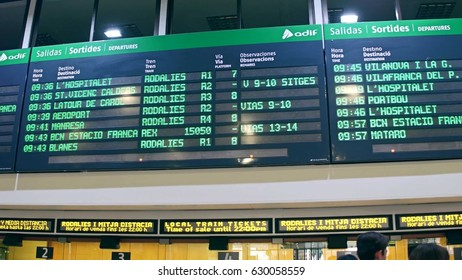 BARCELONA, SPAIN - APRIL, 15, 2017. Electronic departure board above ticket office at railroad terminal