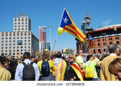 BARCELONA, SPAIN - APRIL 15, 2018: Catalans take part in the Llibertat Presos Politics (free political prisoners) protest march at Placa Espanya in support of jailed Catalan politicians.