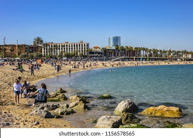 BARCELONA, SPAIN - APRIL 17, 2018: View of Barceloneta beach. Barceloneta beach is oldest and most famous in city of Barcelona, located in neighborhood of La Barceloneta (Ciutat Vella).