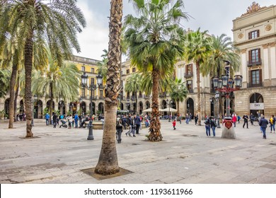 BARCELONA, SPAIN - APRIL 17, 2018: Plaza Real (Royal Plaza) - one of most famous squares of city Barcelona, located in Gothic Quarter, next to La Rambla, is a well-known tourist attraction.