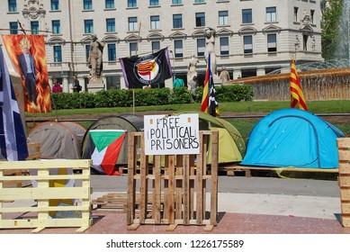BARCELONA, SPAIN - APRIL 17, 2018: LLibertat Presos Politics (Free Political Prisoners) camp in Placa Catalunya. The campaign backs Catalan politicians jailed after the declaration of independence.