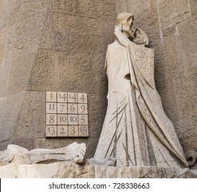 BARCELONA, SPAIN - APRIL 18, 2015: A scene on the Passion Facade of the Sagrada Familia portrays Judas kissing Jesus. The numbers in the Subirachs Magic Square allude to the age of Jesus (33) then.