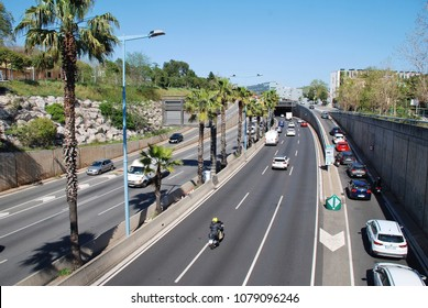 BARCELONA, SPAIN - APRIL 18, 2018: Looking down onto the Ronda de Dalt (B20) ring road at Avinguda Tibidabo. The motorway was built in 1992 for the Summer Olympics.