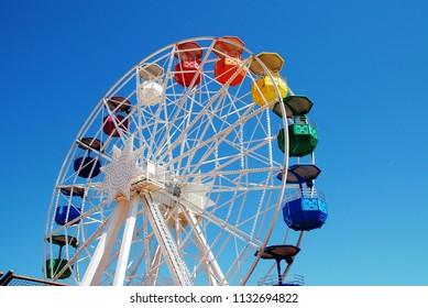 BARCELONA, SPAIN - APRIL 18, 2018: The ferris wheel at the Tibidabo amusement park on Mount Tibidabo. Activities at the park first started in 1901.