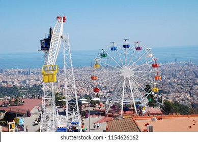 BARCELONA, SPAIN - APRIL 18, 2018: The Tibidabo amusement park on Mount Tibidabo high above the City skyline. The park was first opened in 1901.