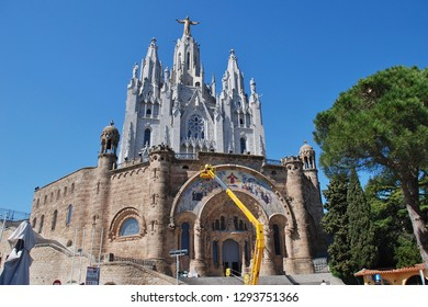 BARCELONA, SPAIN - APRIL 18, 2018: Maintenance work being carried out on the Temple of the Sacred Heart of Jesus on the summit of Mount Tibidabo. Started in 1901, the building was completed in 1961.