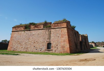 BARCELONA, SPAIN - APRIL 19, 2018: The fortified walls of Montjuic castle on the summit of Montjuic hill. The castle in its present form dates from 1779.