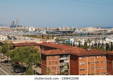 BARCELONA, SPAIN - APRIL 19, 2018: Looking down from Montjuic hill towards apartment blocks and Port Vell. The port was developed in 1992 as part of an urban renewal program for the Barcelona Olympics