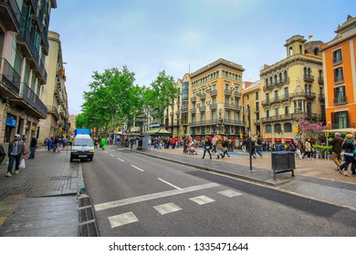 BARCELONA, SPAIN - April 20, 2015: La Rambla in Barcelona, Spain. La Rambla is a street in central Barcelona, between El Raval and Barri Gotic districts