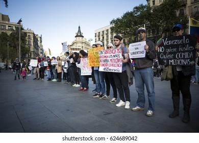 BARCELONA, SPAIN - APRIL 2017 - Venezuelan people prortest in Barcelona against Venezuelan Politicians on April 19, 2017 in Urquinaona Square, Barcelona, Spain.