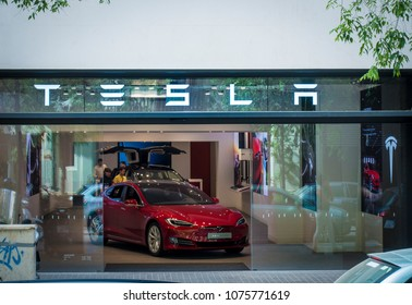 Barcelona, Spain. April 2018: Tesla inc cars flagship store near Passeig de Gracia luxury shopping street with Tesla logo and an electric cars model S and X inside