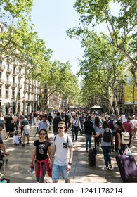 BARCELONA, SPAIN - April 21, 2018: Hundreds of people promenading in the busiest street of Barcelona, the Ramblas.