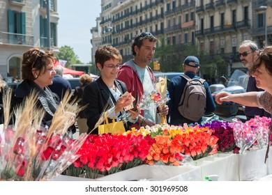 BARCELONA , SPAIN - APRIL 23, 2015: Diada de Sant Jordi or Saint George's Day, a famous Catalan celebration. Traditionally, men gave women roses, and women gave men a book.