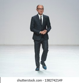 BARCELONA / SPAIN - APRIL 24: designer Jimmy Choo at the end of The Atelier catwalk during the Barcelona Bridal Fashion Week runway collection 2020 on April 24, 2019 in Barcelona, Spain.