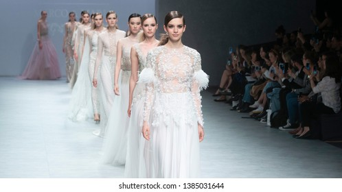 BARCELONA / SPAIN - APRIL 24: models walking on the Marco & Maria catwalk during the Barcelona Bridal Fashion Week runway collection 2020 on April 24, 2019 in Barcelona, Spain.